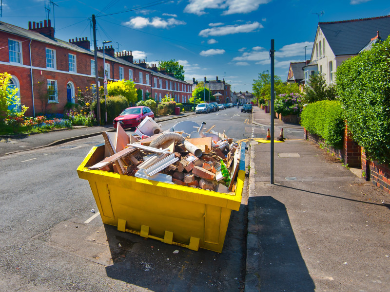 Disposing of waste in a skip