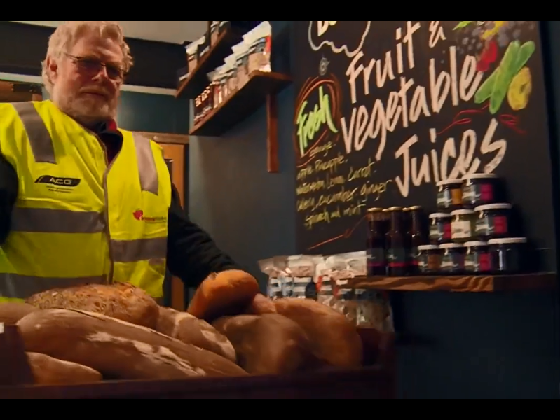 A still image from the Feed People Not Landfill video