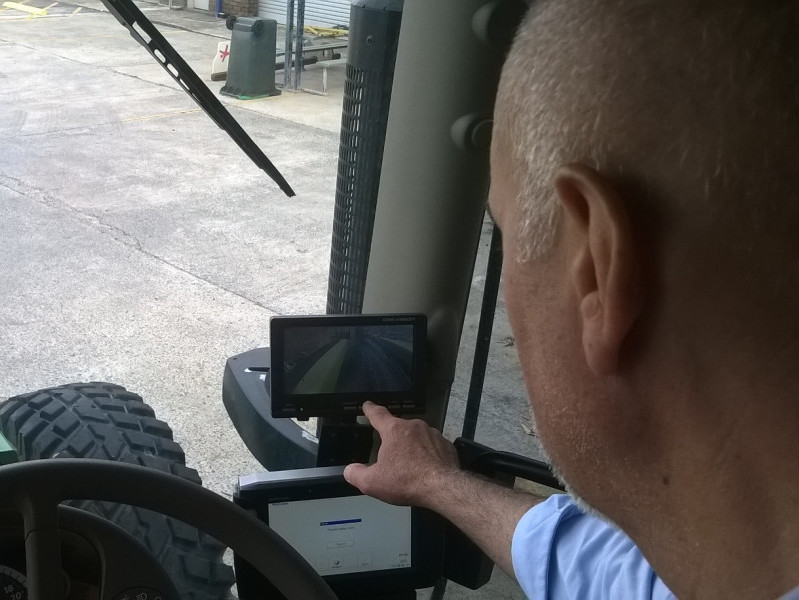 A driver using the tablets showing DVR coverage from around the truck