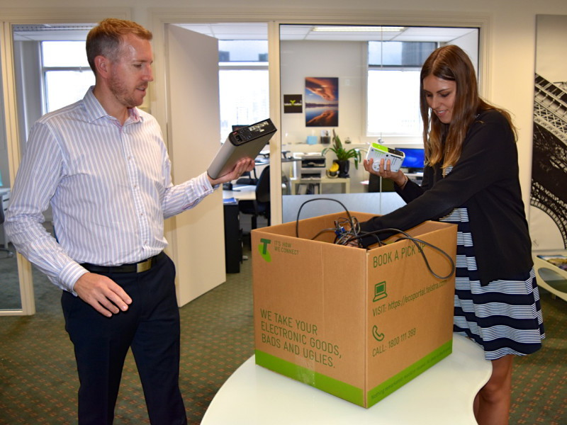 Talent Nation's CEO and an employee filling an eCycle box
