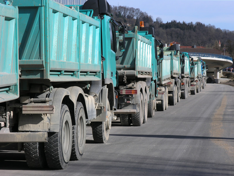 Waste trucks transporting waste